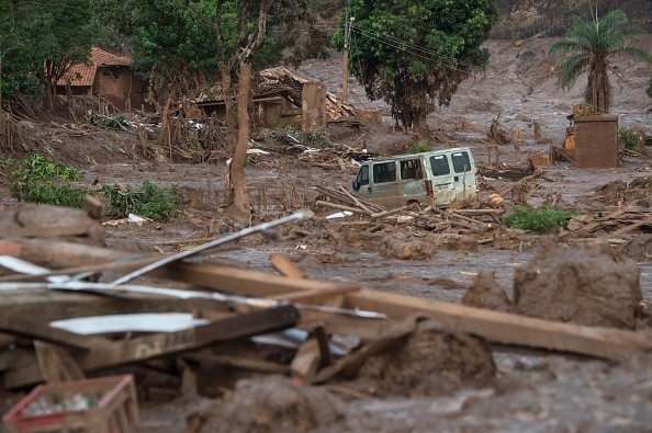 Partial view of mud-covered Bento Rodrigues, three days after an avalanche of mud and mining sludge buried the town in southeastern Brazil, on November 8, 2015. The tragedy left at least 13 people dead, with the fate of 15 others still unknown, the governor of Minas Gerais state Fernando Pimentel told reporters.  AFP PHOTO / CHRISTOPHE SIMON        (Photo credit should read CHRISTOPHE SIMON/AFP/Getty Images)